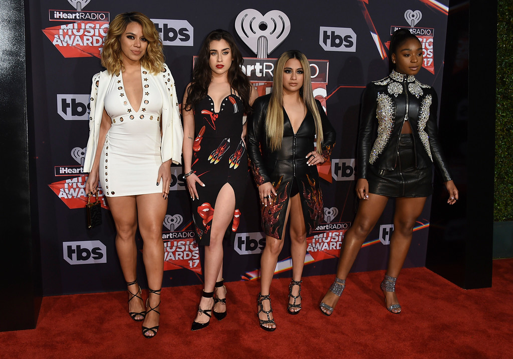 . Fifth Harmony members from left, Dinah Jane, Lauren Jauregui, Ally Brooke, and Normani Kordei arrive at the iHeartRadio Music Awards at the Forum on Sunday, March 5, 2017, in Inglewood, Calif. (Photo by Jordan Strauss/Invision/AP)