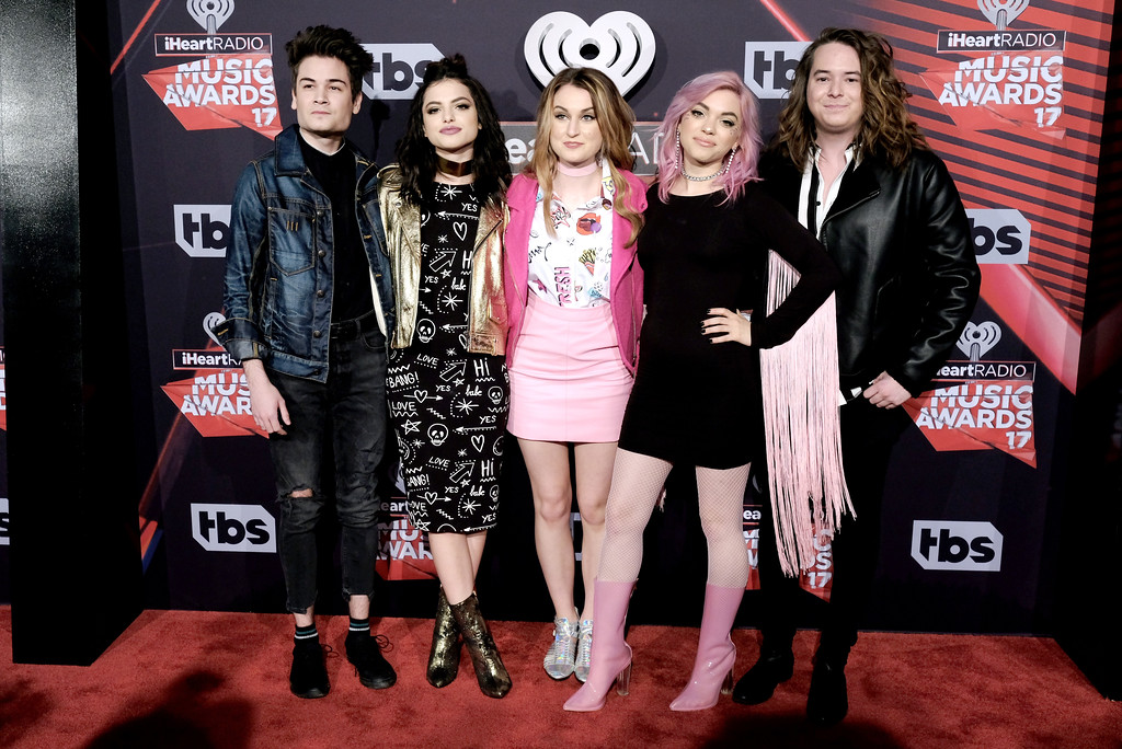 . INGLEWOOD, CA - MARCH 05:  (L-R) Musicians Iain Shipp, Nia Lovelis, Miranda Miller, Rena Lovelis and Casey Moreta of the group Hey Violet attend the 2017 iHeartRadio Music Awards which broadcast live on Turner\'s TBS, TNT, and truTV at The Forum on March 5, 2017 in Inglewood, California.  (Photo by Alberto E. Rodriguez/Getty Images)