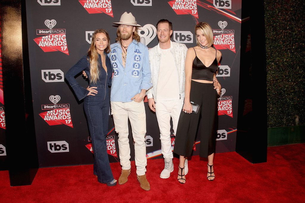 . INGLEWOOD, CA - MARCH 05:  Musicians Brian Kelley (2nd L) and Tyler Hubbard (2nd R) of Florida Georgia Line with Brittney Marie Cole (L) and Hayley Stommel (R) attend the 2017 iHeartRadio Music Awards which broadcast live on Turner\'s TBS, TNT, and truTV at The Forum on March 5, 2017 in Inglewood, California.  (Photo by Jesse Grant/Getty Images for iHeartMedia)