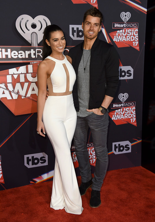 . Ashley Iaconetti, left, and Luke Pell arrive at the iHeartRadio Music Awards at the Forum on Sunday, March 5, 2017, in Inglewood, Calif. (Photo by Jordan Strauss/Invision/AP)