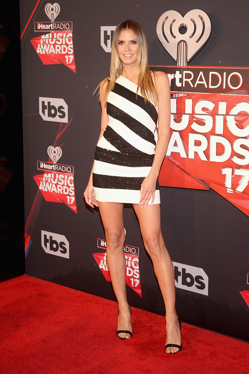 . INGLEWOOD, CA - MARCH 05:  TV personality Heidi Klum attends the 2017 iHeartRadio Music Awards which broadcast live on Turner\'s TBS, TNT, and truTV at The Forum on March 5, 2017 in Inglewood, California.  (Photo by Jesse Grant/Getty Images for iHeartMedia)
