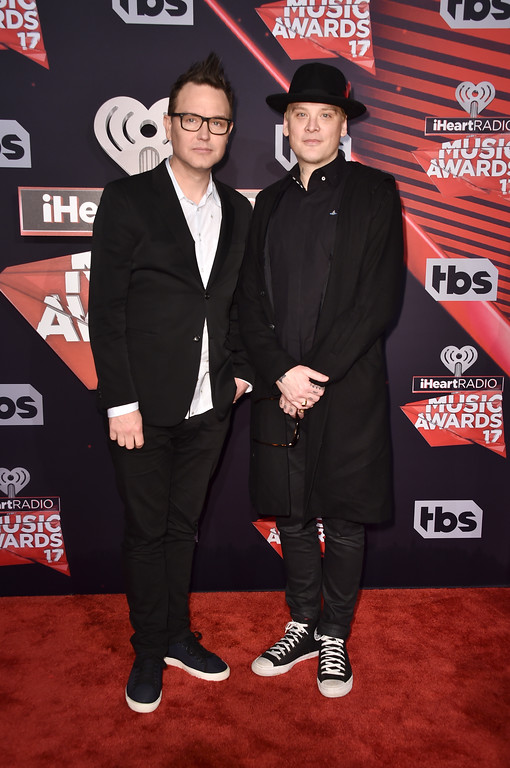 . INGLEWOOD, CA - MARCH 05:  Musicians Mark Hoppus (L) and Matt Skiba of music group blink-182 attend the 2017 iHeartRadio Music Awards which broadcast live on Turner\'s TBS, TNT, and truTV at The Forum on March 5, 2017 in Inglewood, California.  (Photo by Alberto E. Rodriguez/Getty Images)
