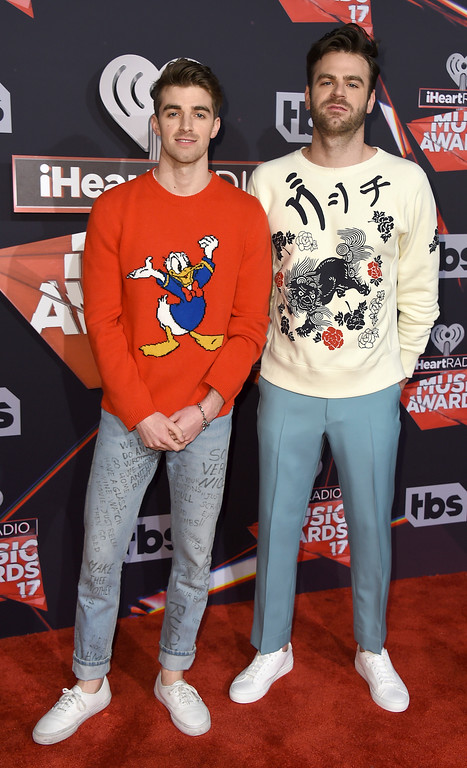 . Drew Taggart, left, and Alex Pall, of The Chainsmokers, arrive at the iHeartRadio Music Awards at the Forum on Sunday, March 5, 2017, in Inglewood, Calif. (Photo by Jordan Strauss/Invision/AP)