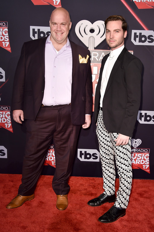 . INGLEWOOD, CA - MARCH 05:  Comedian Guy Branum (L) and Chris Schleicher attend the 2017 iHeartRadio Music Awards which broadcast live on Turner\'s TBS, TNT, and truTV at The Forum on March 5, 2017 in Inglewood, California.  (Photo by Alberto E. Rodriguez/Getty Images)
