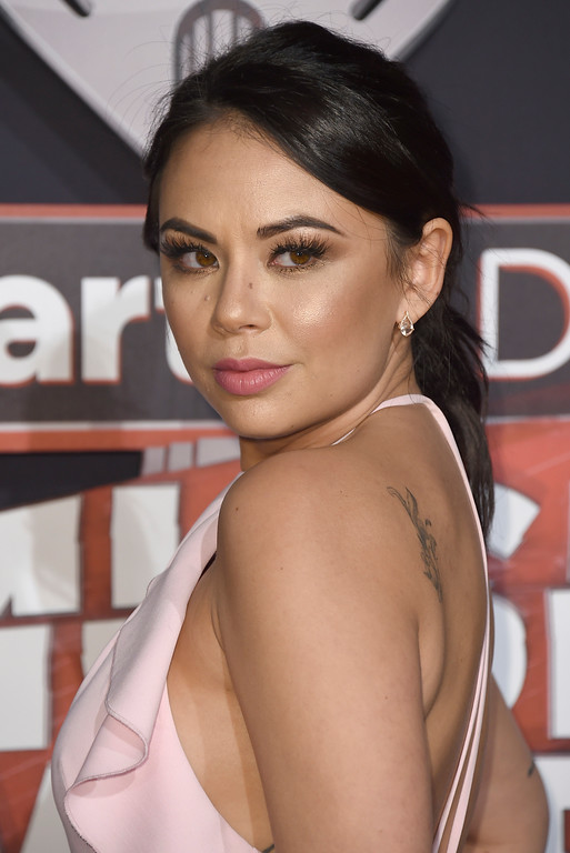 . Janel Parrish arrives at the iHeartRadio Music Awards at the Forum on Sunday, March 5, 2017, in Inglewood, Calif. (Photo by Jordan Strauss/Invision/AP)
