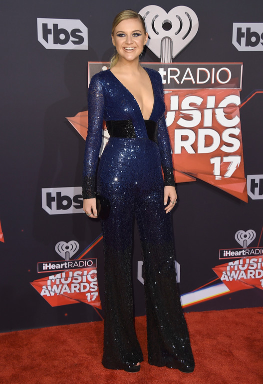 . Kelsea Ballerini arrives at the iHeartRadio Music Awards at the Forum on Sunday, March 5, 2017, in Inglewood, Calif. (Photo by Jordan Strauss/Invision/AP)