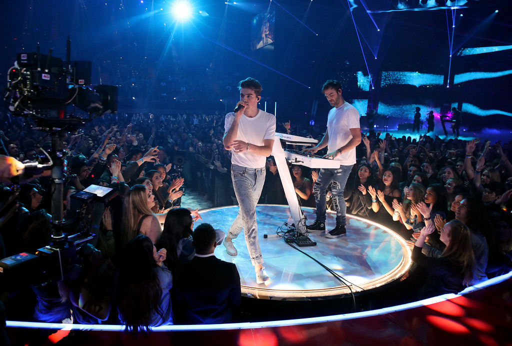 . INGLEWOOD, CA - MARCH 05:  Recording artists Andrew Taggart (L) and Alex Pall of The Chainsmokers perform onstage at the 2017 iHeartRadio Music Awards which broadcast live on Turner\'s TBS, TNT, and truTV at The Forum on March 5, 2017 in Inglewood, California.  (Photo by Christopher Polk/Getty Images for iHeartMedia)
