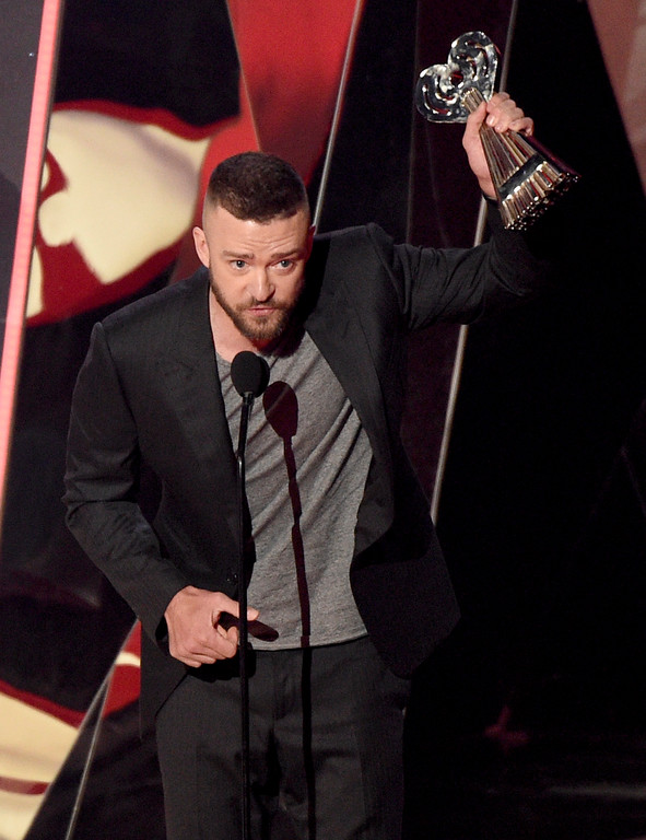 ". Justin Timberlake accepts the award for song of the year for ""Can\'t Stop The Feeling!\"" at the iHeartRadio Music Awards at the Forum on Sunday, March 5, 2017, in Inglewood, Calif. (Photo by Chris Pizzello/Invision/AP)"
