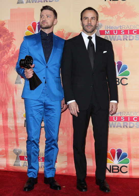 . Justin Timberlake, winner of the iHeartRadio Innovator award, left, and Tom Ford pose in the press room at the iHeartRadio Music Awards at The Shrine Auditorium on Sunday, March 29, 2015, in Los Angeles. (Photo by John Salangsang/Invision/AP)