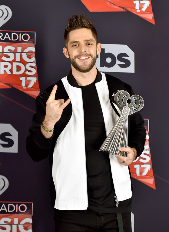. INGLEWOOD, CA - MARCH 05:  Singer-songwriter Thomas Rhett, winner of the Country Artist of the Year award, poses in the press room at the 2017 iHeartRadio Music Awards which broadcast live on Turner\'s TBS, TNT, and truTV at The Forum on March 5, 2017 in Inglewood, California.  (Photo by Alberto E. Rodriguez/Getty Images)