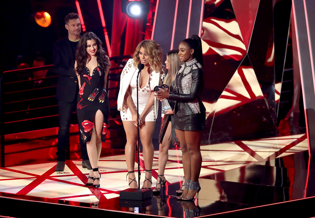 . INGLEWOOD, CA - MARCH 05:  (L-R) Singers Lauren Jauregui, Dinah Jane, Ally Brooke and Normani Kordei of Fifth Harmony accept the Best Fan Army award onstage from host Ryan Seacrest at the 2017 iHeartRadio Music Awards which broadcast live on Turner\'s TBS, TNT, and truTV at The Forum on March 5, 2017 in Inglewood, California.  (Photo by Rich Polk/Getty Images for iHeartMedia)