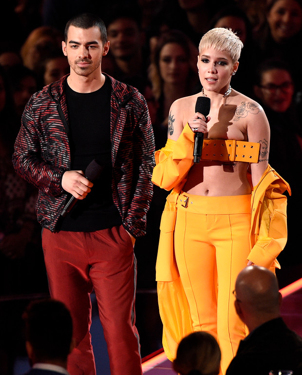 . Joe Jonas, left, and Halsey introduce a performance by Big Sean at the iHeartRadio Music Awards at the Forum on Sunday, March 5, 2017, in Inglewood, Calif. (Photo by Chris Pizzello/Invision/AP)