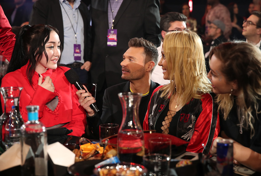 . INGLEWOOD, CA - MARCH 05:  (L-R) Singer-songwriter Noah Cyrus, host Ryan Seacrest, Tish Cyrus, and singer-songwriter Miley Cyrus attend at the 2017 iHeartRadio Music Awards which broadcast live on Turner\'s TBS, TNT, and truTV at The Forum on March 5, 2017 in Inglewood, California.  (Photo by Christopher Polk/Getty Images for iHeartMedia)