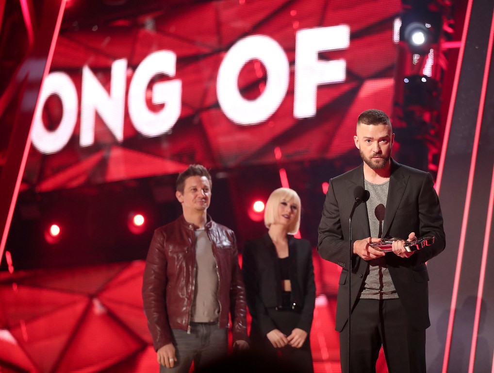 . INGLEWOOD, CA - MARCH 05:  Actor Jeremy Renner (L) listens as musician Justin Timberlake (R, holding award trophy) accepts the Song of the Year award for \'Can\'t Stop the Feeling!\' onstage at the 2017 iHeartRadio Music Awards which broadcast live on Turner\'s TBS, TNT, and truTV at The Forum on March 5, 2017 in Inglewood, California.  (Photo by Christopher Polk/Getty Images for iHeartMedia)