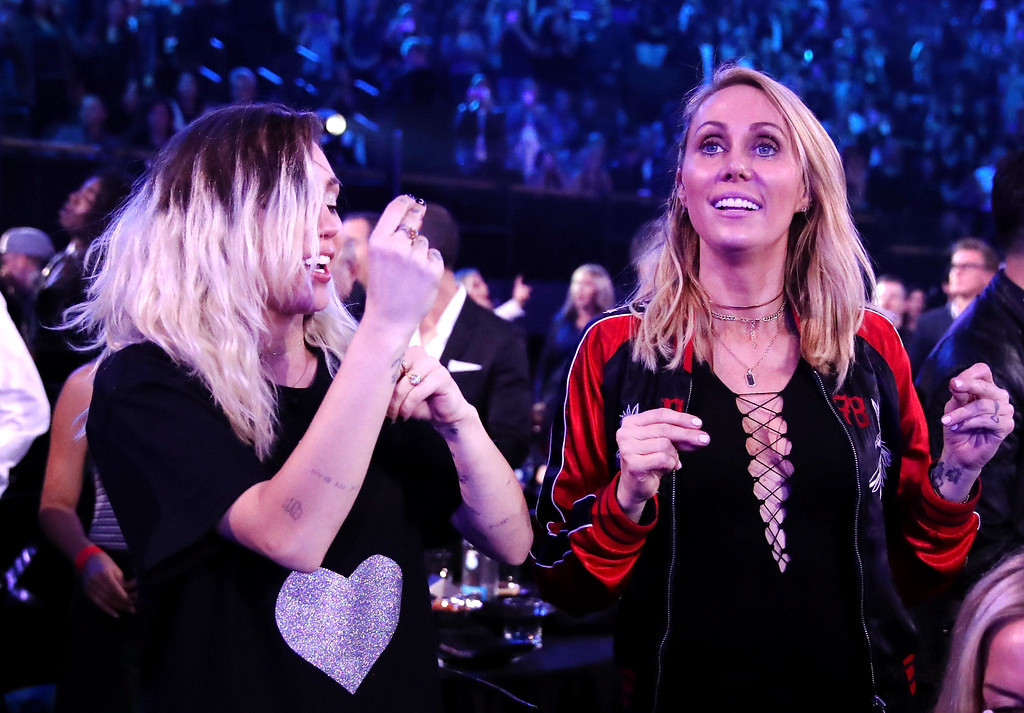 . INGLEWOOD, CA - MARCH 05:  Singer-songwriter Miley Cyrus (L) and Tish Cyrus react during the 2017 iHeartRadio Music Awards which broadcast live on Turner\'s TBS, TNT, and truTV at The Forum on March 5, 2017 in Inglewood, California.  (Photo by Christopher Polk/Getty Images for iHeartMedia)