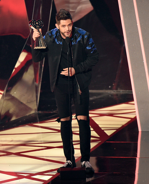 . Thomas Rhett accepts the award for country artist of the year at the iHeartRadio Music Awards at the Forum on Sunday, March 5, 2017, in Inglewood, Calif. (Photo by Chris Pizzello/Invision/AP)