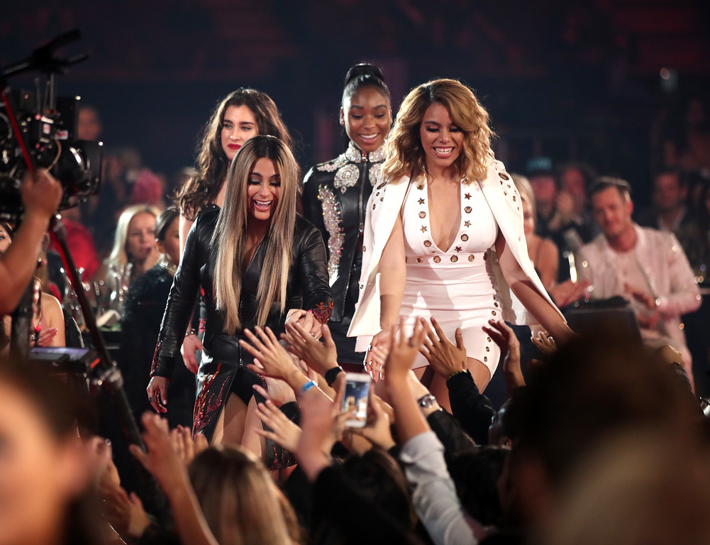 . INGLEWOOD, CA - MARCH 05:  (L-R) Singers Lauren Jauregui, Ally Brooke, Normani Kordei, and Dinah Jane of music group Fifth Harmony react during the 2017 iHeartRadio Music Awards which broadcast live on Turner\'s TBS, TNT, and truTV at The Forum on March 5, 2017 in Inglewood, California.  (Photo by Christopher Polk/Getty Images for iHeartMedia)