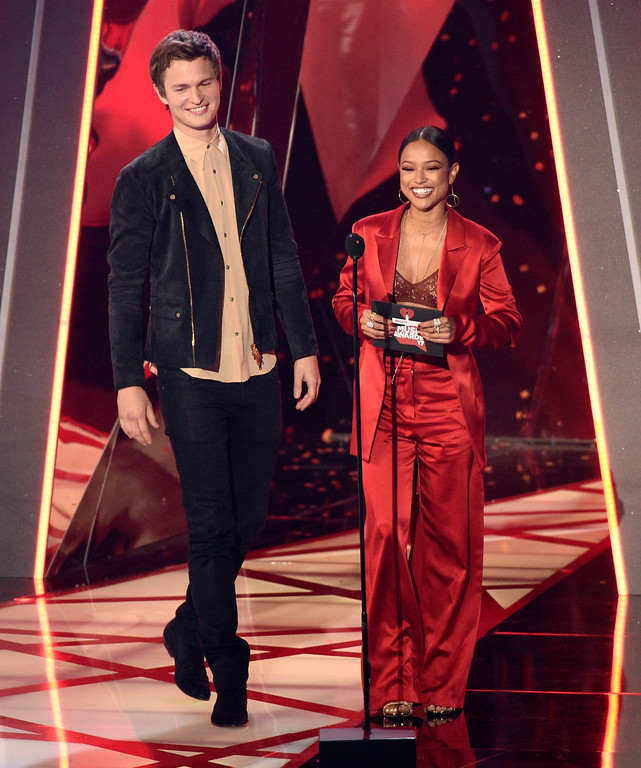 . Ansel Elgort, left, and Karrueche Tran present the award for dance song of the year at the iHeartRadio Music Awards at the Forum on Sunday, March 5, 2017, in Inglewood, Calif. (Photo by Chris Pizzello/Invision/AP)