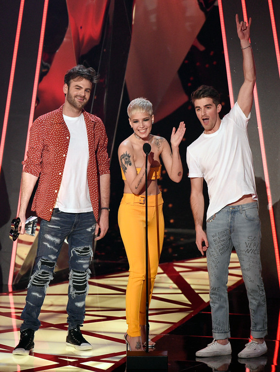 ". Alex Pall, from left, and Drew Taggart, right, of the Chainsmokers, and Halsey accept the award for dance song of the year for ""Closer\"" at the iHeartRadio Music Awards at the Forum on Sunday, March 5, 2017, in Inglewood, Calif. (Photo by Chris Pizzello/Invision/AP)"