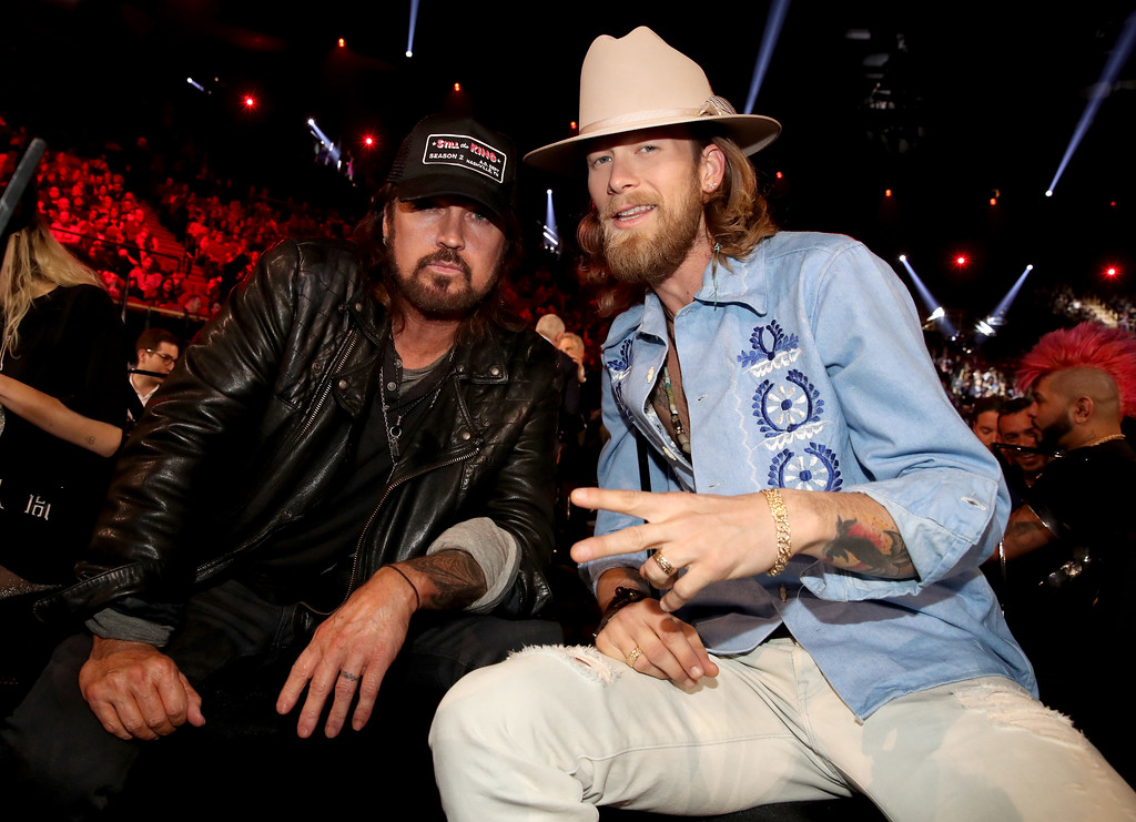 . INGLEWOOD, CA - MARCH 05:  Singer-songwriter Billy Ray Cyrus (L) and singer-songwriter Brian Kelley of music group Florida Georgia Line pose during the 2017 iHeartRadio Music Awards which broadcast live on Turner\'s TBS, TNT, and truTV at The Forum on March 5, 2017 in Inglewood, California.  (Photo by Christopher Polk/Getty Images for iHeartMedia)