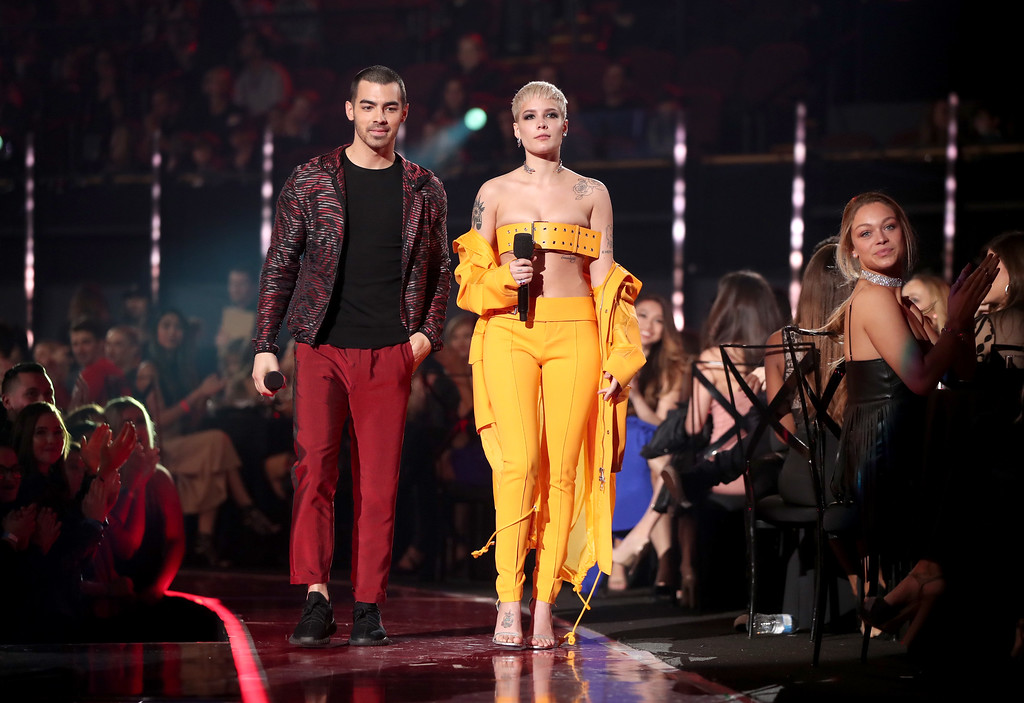 . INGLEWOOD, CA - MARCH 05:  Musicians Joe Jonas (L) of music group DNCE and Halsey walk onstage at the 2017 iHeartRadio Music Awards which broadcast live on Turner\'s TBS, TNT, and truTV at The Forum on March 5, 2017 in Inglewood, California.  (Photo by Christopher Polk/Getty Images for iHeartMedia)