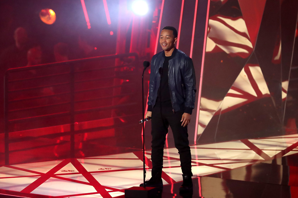 . INGLEWOOD, CA - MARCH 05: Musician John Legend speaks onstage at the 2017 iHeartRadio Music Awards which broadcast live on Turner\'s TBS, TNT, and truTV at The Forum on March 5, 2017 in Inglewood, California.  (Photo by Rich Polk/Getty Images for iHeartMedia)