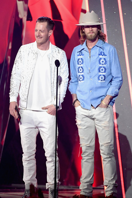 . INGLEWOOD, CA - MARCH 05:  Musicians Tyler Hubbard (L) and Brian Kelley of Florida Georgia Line speak onstage at the 2017 iHeartRadio Music Awards which broadcast live on Turner\'s TBS, TNT, and truTV at The Forum on March 5, 2017 in Inglewood, California.  (Photo by Kevin Winter/Getty Images for iHeartMedia)
