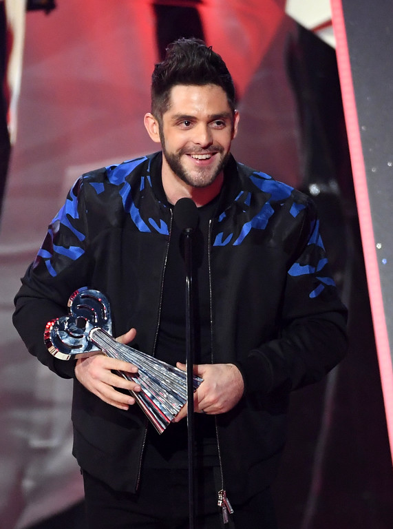 . INGLEWOOD, CA - MARCH 05:  Musician Thomas Rhett accepts Country Artist of the Year onstage at the 2017 iHeartRadio Music Awards which broadcast live on Turner\'s TBS, TNT, and truTV at The Forum on March 5, 2017 in Inglewood, California.  (Photo by Kevin Winter/Getty Images for iHeartMedia)