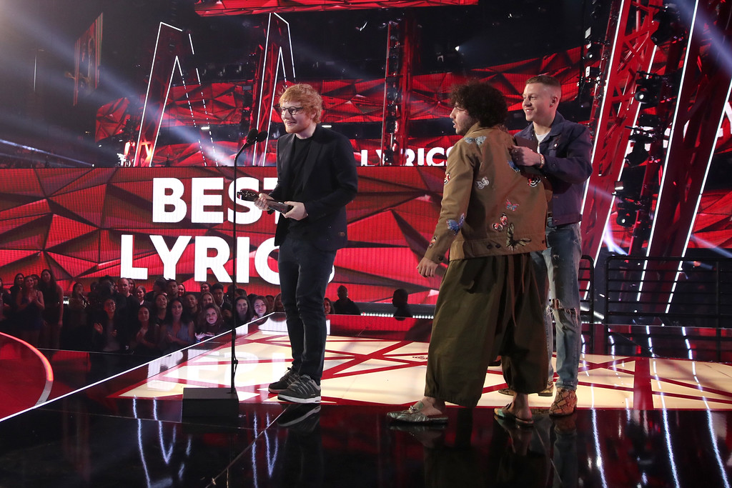 . INGLEWOOD, CA - MARCH 05:  (L-R) Singer-songwriter Ed Sheeran and producer-songwriter Benny Blanco accept the Best Lyrics award for \'Love Yourself\' from recording artist Macklemore onstage at the 2017 iHeartRadio Music Awards which broadcast live on Turner\'s TBS, TNT, and truTV at The Forum on March 5, 2017 in Inglewood, California.  (Photo by Christopher Polk/Getty Images for iHeartMedia)