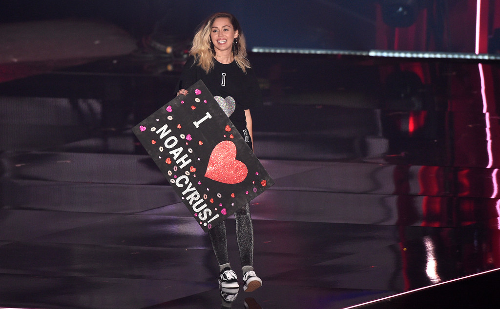 . Miley Cyrus walks on stage to introduce a performance by Noah Cyrus and Labrinth at the iHeartRadio Music Awards at the Forum on Sunday, March 5, 2017, in Inglewood, Calif. (Photo by Chris Pizzello/Invision/AP)