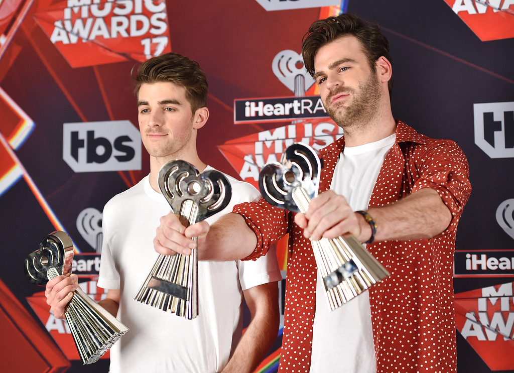 . INGLEWOOD, CA - MARCH 05:  Recording artists Andrew Taggart (L) and Alex Pall of music group The Chainsmokers, winners of the Best New Artist award, Dance Song of the Year award for \'Closer,\' and Best New Pop Artist award, pose in the press room at the 2017 iHeartRadio Music Awards which broadcast live on Turner\'s TBS, TNT, and truTV at The Forum on March 5, 2017 in Inglewood, California.  (Photo by Alberto E. Rodriguez/Getty Images)