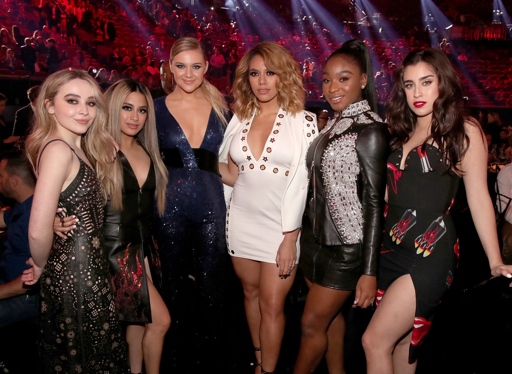 . INGLEWOOD, CA - MARCH 05:  Singers Sabrina Carpenter (L) and Kelsea Ballerini (3rd from L) pose with singers (from 2nd L) Ally Brooke, Dinah Jane, Normani Kordei, and Lauren Jauregui of music group Fifth Harmony during the 2017 iHeartRadio Music Awards which broadcast live on Turner\'s TBS, TNT, and truTV at The Forum on March 5, 2017 in Inglewood, California.  (Photo by Christopher Polk/Getty Images for iHeartMedia)