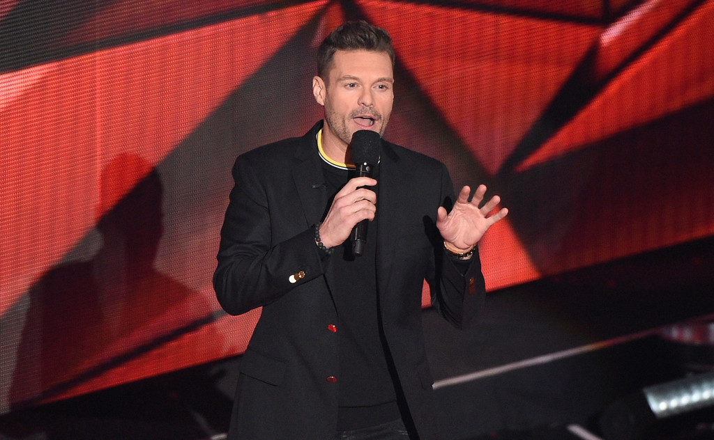 . Ryan Seacrest speaks on stage during the iHeartRadio Music Awards at the Forum on Sunday, March 5, 2017, in Inglewood, Calif. (Photo by Chris Pizzello/Invision/AP)