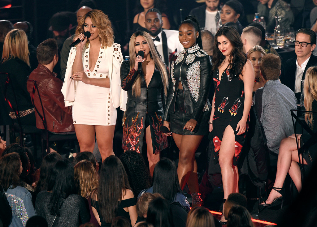 . Members of Fifth Harmony from left, Dinah Jane, Ally Brooke, Normani Kordei and Lauren Jauregui, of Fifth Harmony, introduce a performance by Thomas Rhett at the iHeartRadio Music Awards at the Forum on Sunday, March 5, 2017, in Inglewood, Calif. (Photo by Chris Pizzello/Invision/AP)