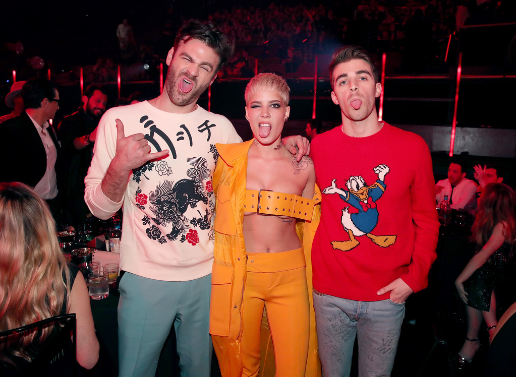. INGLEWOOD, CA - MARCH 05:  Singer Halsey (C) poses with recording artists Alex Pall (L) and Andrew Taggart (R) of music group The Chainsmokers during the 2017 iHeartRadio Music Awards which broadcast live on Turner\'s TBS, TNT, and truTV at The Forum on March 5, 2017 in Inglewood, California.  (Photo by Christopher Polk/Getty Images for iHeartMedia)