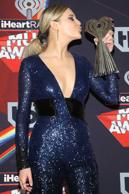 . INGLEWOOD, CA - MARCH 05:  Singer-songwriter Kelsea Ballerini, winner of the Best New Country Artist award, poses in the press room at the 2017 iHeartRadio Music Awards which broadcast live on Turner\'s TBS, TNT, and truTV at The Forum on March 5, 2017 in Inglewood, California.  (Photo by Jesse Grant/Getty Images for iHeartMedia)