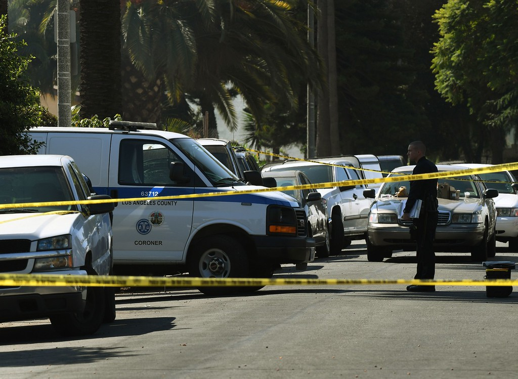 . Police and investigators at the scene where three people killed during a shooting after a dispute at at a pop-up Jamaican restaurant in Los Angeles on October 15, 2016. Three people were killed and at least a dozen more injured, police said Saturday. One person has been arrested and police have launched a manhunt for another in connection with the deadly incident in West Adams, in the southwestern part of the metro area, said spokesman Lieutenant Chuck Springer. (RALSTON/AFP/Getty Images)