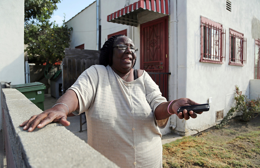 ". Sheryl Cobb, who lives just down the block from, talks about her experience as Los Angeles police investigators Saturday, Oct. 15, 2016 work the scene of a shooting that left three people dead and 12 wounded at a restaurant operating in a home in a Crenshaw District neighborhood of Los Angeles just after midnight Saturday. Police who arrived at the scene in the working class neighborhood dotted by tall palm trees found shell casings and blood throughout the restaurant, located west of downtown Los Angeles. Cobb said she was awakened by screaming and gunfire, but never left her home for fear of getting caught in a crossfire. ""Bullets don\'t have names on them,\"" she said. (AP Photo/Reed Saxon)"