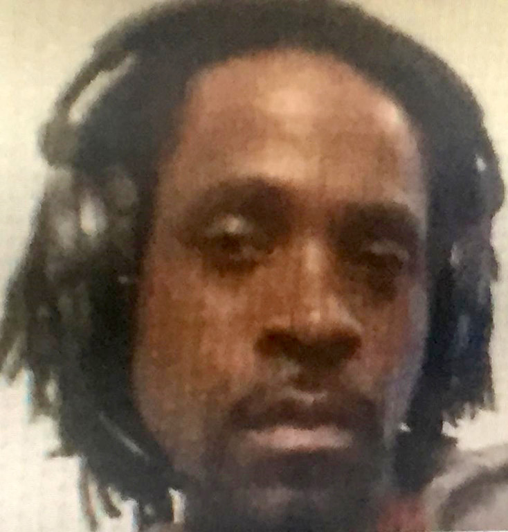 ". This undated photo provided by the Fresno Police Department shows Kori Ali Muhammad, 39, who was arrested shortly after a shooting rampage outside a Catholic Charities building, in Fresno, Calif, on Tuesday, April 18, 2017. Muhammad is believed to have shot and killed three people on the streets of downtown Fresno on Tuesday, shouting ""God is great\"" in Arabic during at least one of the slayings and later telling police that he hates white people, authorities said. (Fresno Police Department via AP)"
