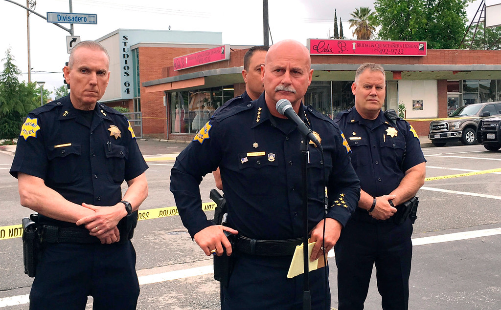 ". Fresno police chief Jerry Dyer, front, briefs reporters in Fresno, Calif., after a shooting Tuesday, April 18, 2017. A man shot and killed three people on the streets of downtown Fresno shouting ""God is great\"" in Arabic during at least one of the slayings and later telling police that he hates white people, authorities said. (AP Photo/Scott Smith)"