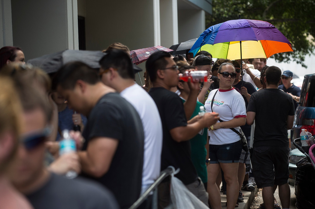 . Hundreds of volunteers line up to donate blood at OneBlood Center after the late night shooting at Pulse, an Orlando night club, on Sunday, June 12, 2016 in Orlando. A gunman wielding an assault-type rifle and a handgun opened fire inside a crowded Florida nightclub before dying in a gunfight with SWAT officers, police say. The attack left at least 50 people dead, making it the worst mass shooting in American history. (Zack Wittman/Tampa Bay Times via AP)