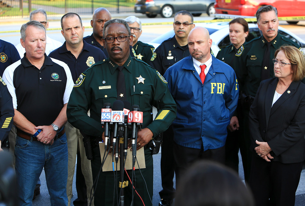 . Law enforcement agencies and local city representatves including Orange County Sheriff Jerry Demings, at microphone, hold a press conference on Sunday morning, June 12, 2016, in Orlando regarding the Orlando Pulse nightclub shooting. A gunman wielding an assault-type rifle and a handgun opened fire inside a crowded gay nightclub early Sunday, killing at least 50 people before dying in a gunfight with SWAT officers, police said. It was the worst mass shooting in American history. (Jacob Langston/Orlando Sentinel via AP) MAGS OUT; NO SALES; MANDATORY CREDIT