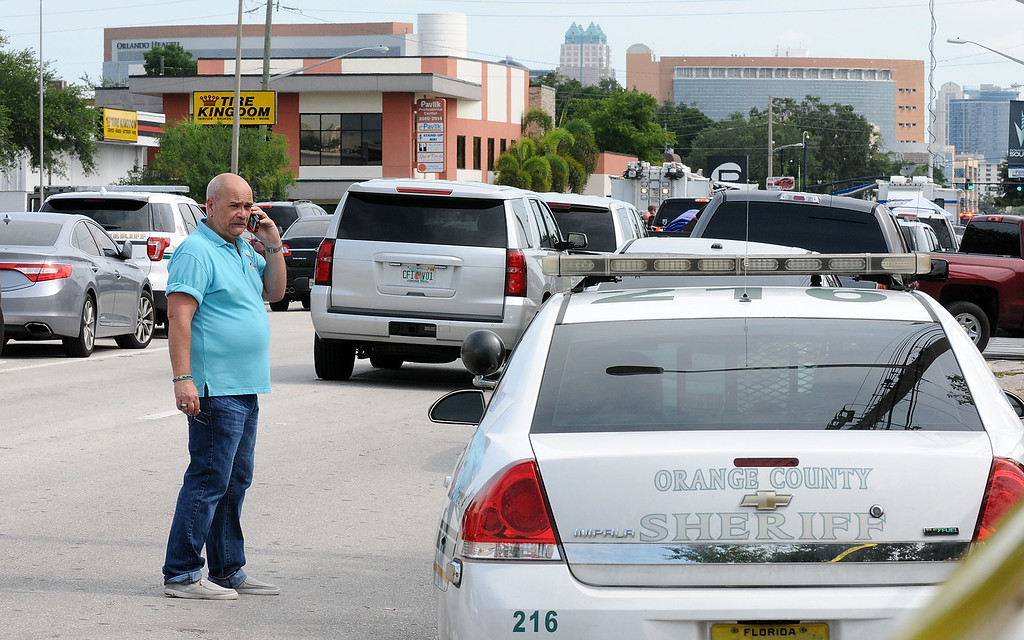 . ORLANDO, FLORIDA - JUNE 12:  Terry DeCarlo (L), executive director of The LGBT Center (Gay, Lesbian,Bisexual, Transgender Community) of central florida on North Mills, waits for information near the Pulse nightclub June 12, 2016 in Orlando, Florida. The suspected shooter, Omar Mateen, was shot and killed by police. 50 people are reported dead and 53 were injured in what is now the worst mass shooting in U.S. history. (Photo by Gerardo Mora/Getty Images)