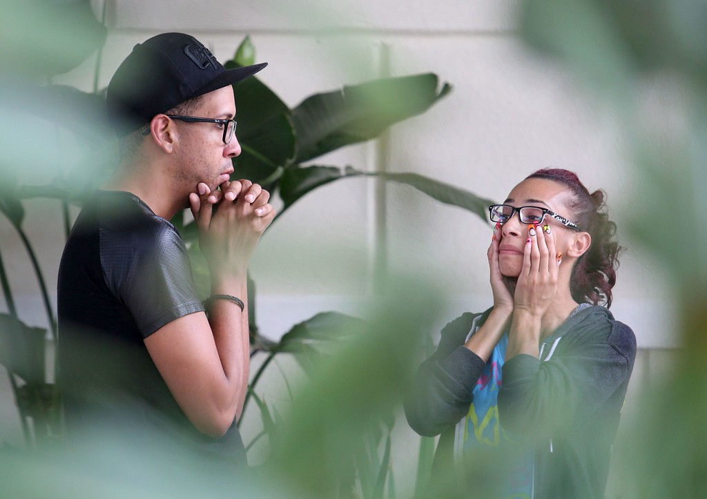 . People react the Pulse nightclub shooting outside the hotel where family members are gathering in Orlando, Florida, on June 12, 2016.  Fifty people died and another 53 were injured when a gunman opened fire and seized hostages at a gay nightclub in Florida, police said June 12, making it the worst mass shooting in US history. (GREGG NEWTON/AFP/Getty Images)