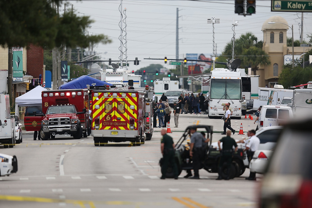. ORLANDO, FL - JUNE 12:  Law enforcement officials investigate near the Pulse Nightclub where Omar Mateen allegedly killed at least 50 people on June 12, 2016 in Orlando, Florida. The mass shooting killed at least 50 people and injuring 53 others in what is the deadliest mass shooting in the country\'s history.  (Photo by Joe Raedle/Getty Images)