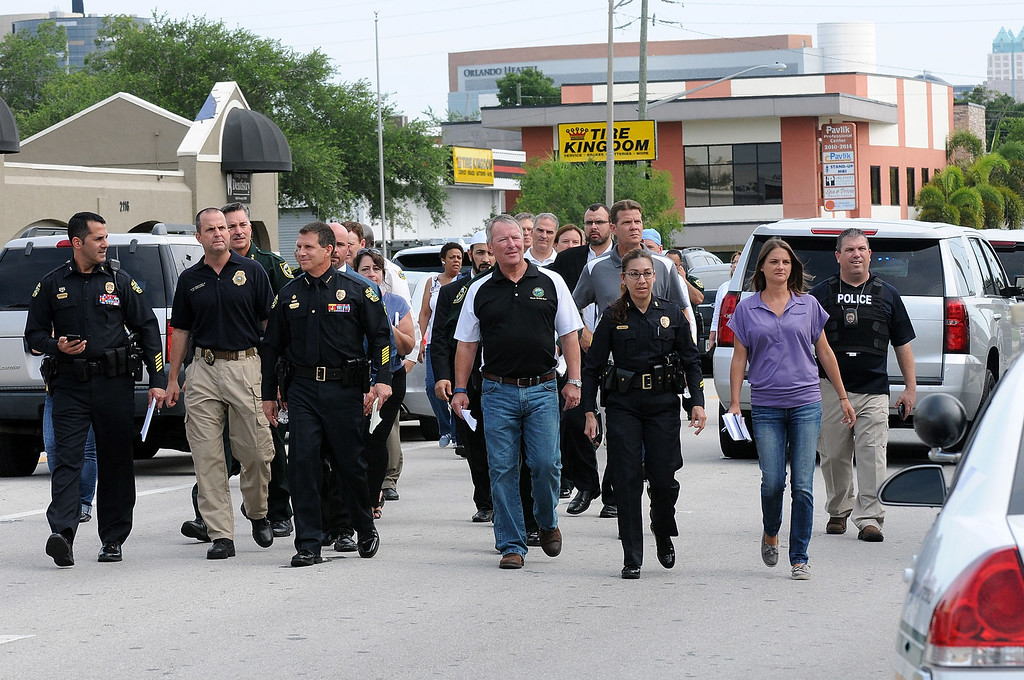 . ORLANDO, FLORIDA - JUNE 12:  Orlando Mayor Buddy Dyer (C) and Orlando Police Chief John Mina arrive for a press conference after the Pulse nightclub terror attack on June 12, 2016 in Orlando, Florida. The suspected shooter, Omar Mateen, was shot and killed by police. 50 people are reported dead and 53 were injured in what is now the worst mass shooting in U.S. history. (Photo by Gerardo Mora/Getty Images)