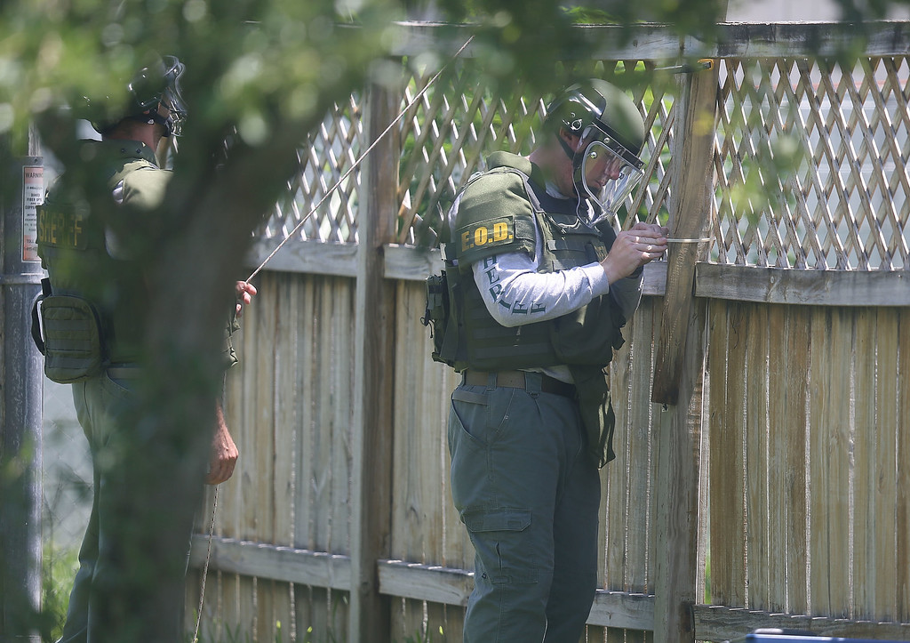 . FORT PIERCE, FL - JUNE 12:  A Bomb Disposal Unit checks for explosives around the apartment building where shooting suspect Omar Mateen is believed to have lived on June 12, 2016 in Fort Pierce, Florida. The mass shooting at Pulse nightclub in Orlando, Florida killed at least 50 people and injured 53 others in what is the deadliest mass shooting in the country\'s history.  (Photo by Joe Raedle/Getty Images)