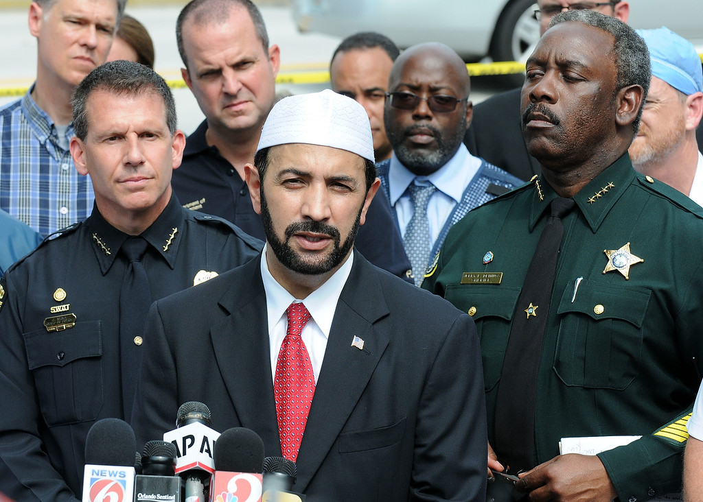 . ORLANDO, FLORIDA - JUNE 12: Muhammad Musri (C), Iman of the Islamic Society of Central Florida law enforcement and local community leaders speak during a press conference June 12, 2016 in Orlando, Florida. 50 people are reported dead and 53 were injured at a mass shooting at the Pulse nightclub in what is now the worst mass shooting in U.S. history. The suspected shooter, Omar Mateen, was shot and killed by police. (Photo by Gerardo Mora/Getty Images)
