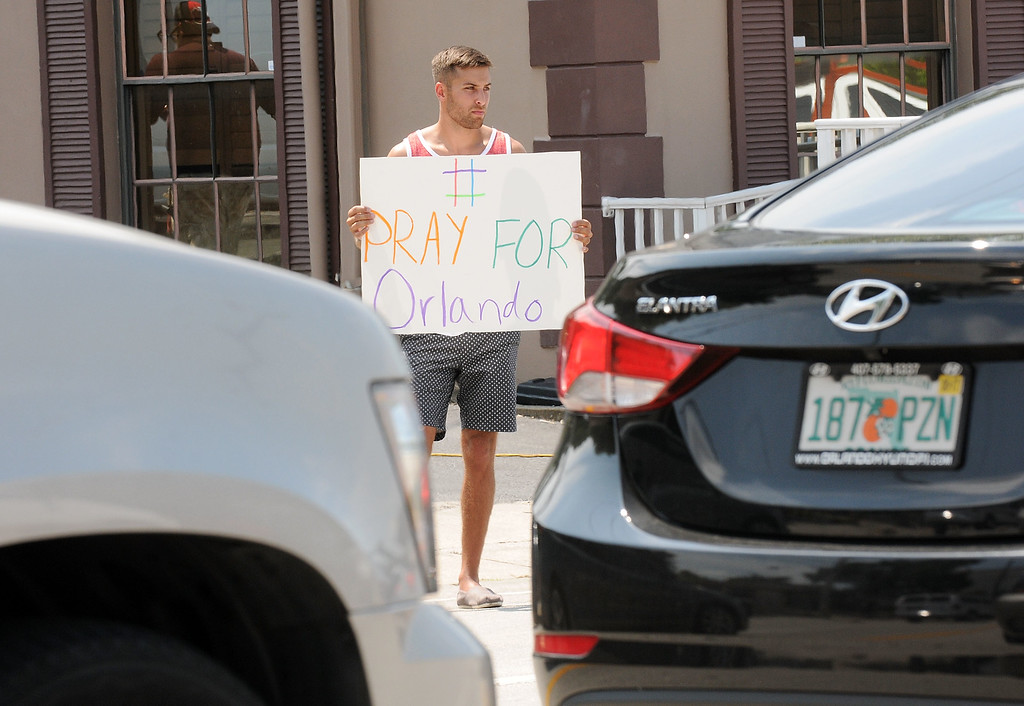 . ORLANDO, FLORIDA - JUNE 12:  A man holds a sign in support of the victims of the terror attack at gay nightclub Pulse on June 12, 2016 in Orlando, Florida. The suspected shooter, Omar Mateen, was shot and killed by police. 50 people are reported dead and 53 were injured in what is now the worst mass shooting in U.S. history. (Photo by Gerardo Mora/Getty Images)