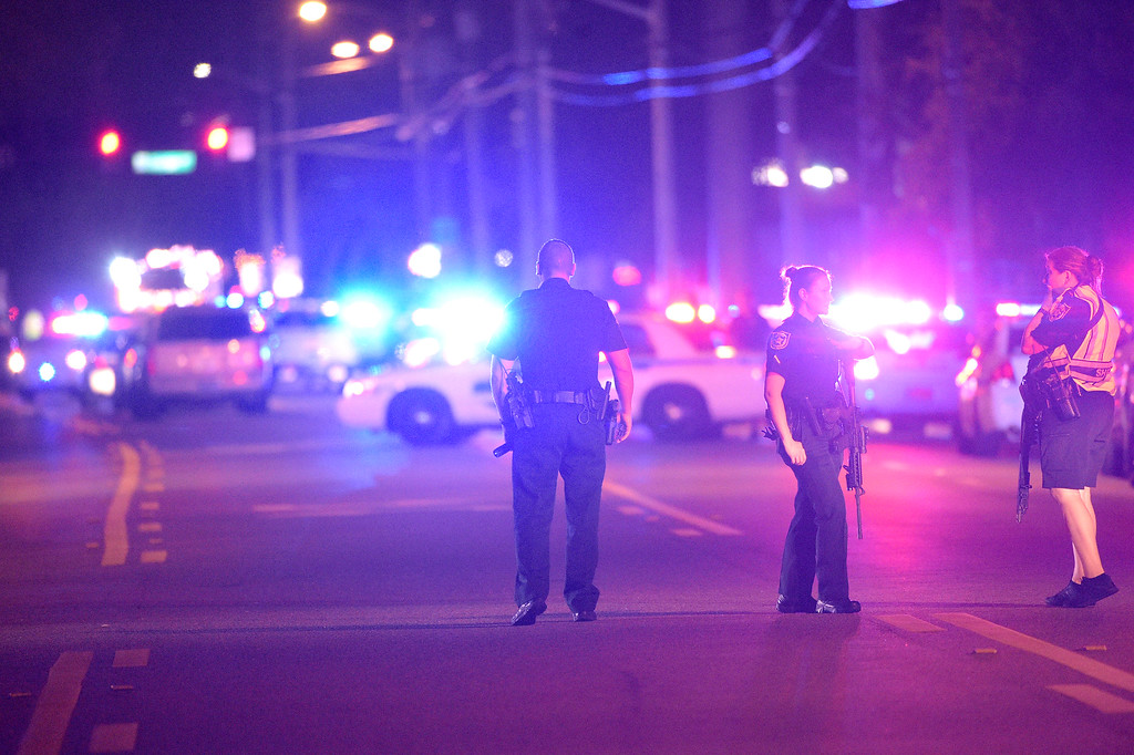 . Police officers stand guard down the street from the scene of a shooting involving multiple fatalities at a nightclub in Orlando, Fla., Sunday, June 12, 2016. (AP Photo/Phelan M. Ebenhack)